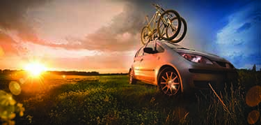 Car and bike in sunset